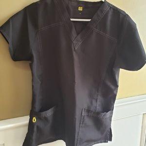 small black scrub top